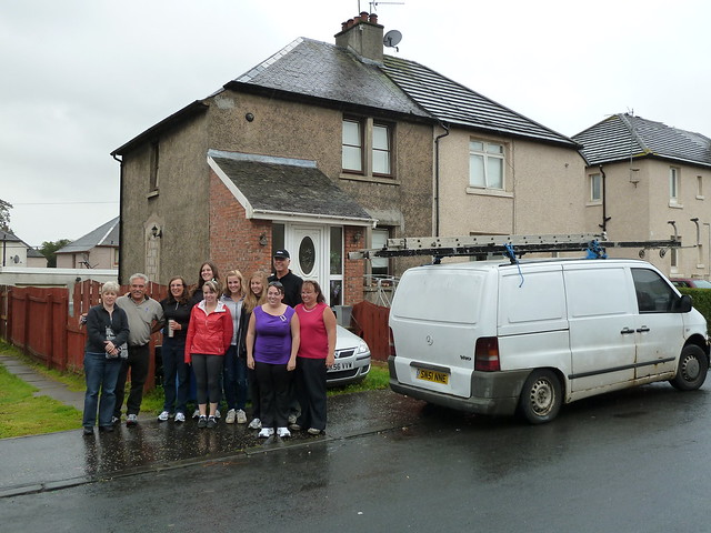 Family group visiting house of ancestor in Falkirk, Scotland