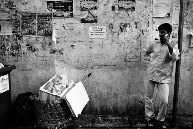 Migrant worker on the phone in Little India.