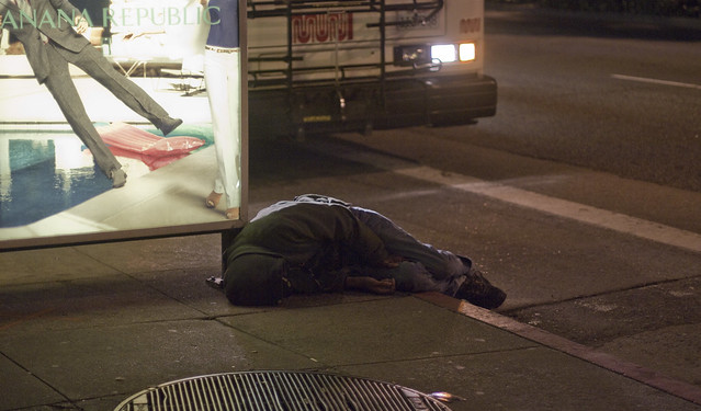 Homeless at a bus stop.  Geary Blvd, The Richmond, San Francisco.  July 14, 2011