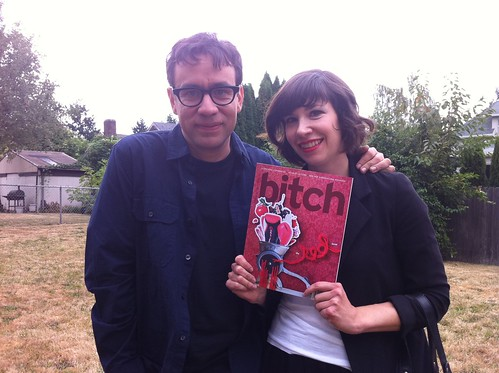 Carrie Brownstein and Fred Armisen holding a copy of Bitch
