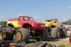 auto racing(0.0), racing(0.0), stock car racing(0.0), race(0.0), dirt track racing(0.0), off road racing(0.0), rally raid(0.0), race track(0.0), mud(0.0), automobile(1.0), vehicle(1.0), truck(1.0), sports(1.0), motorsport(1.0), off-roading(1.0), monster truck(1.0),