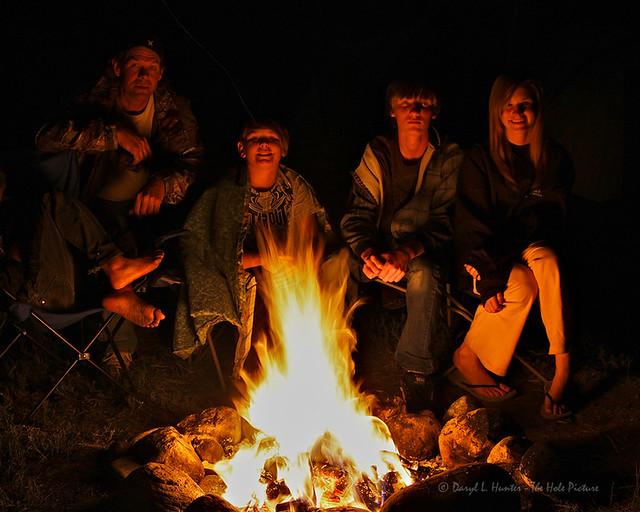 Sitting around campfire nude