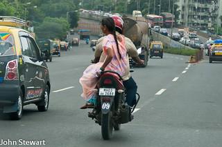 woman sitting side-saddle