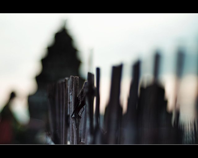 fence, pagoda and the praying man