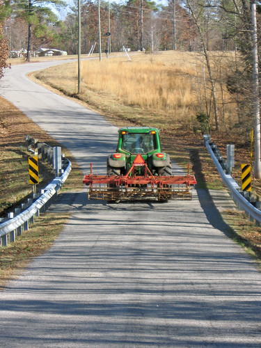 Slow-moving tractor on a rural road.