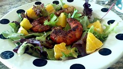 Mixed green salad with orange & blackened prawns
