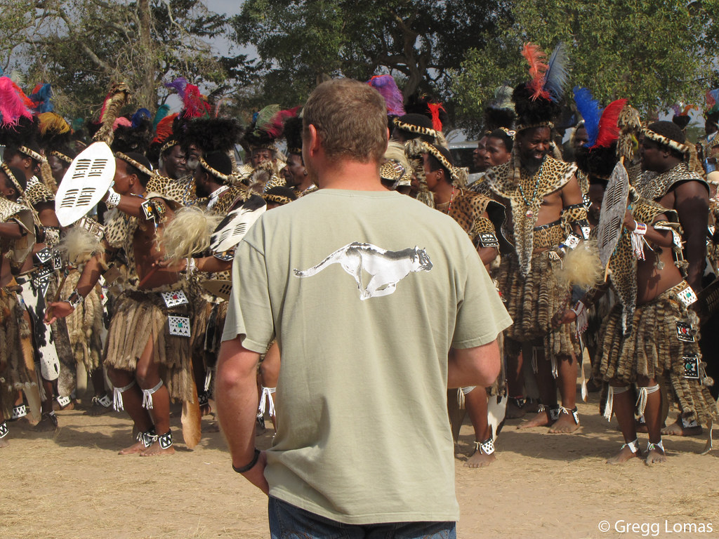 "Panthera Leopard Program Coordinator Tristan Dickerson is shown here investigating the use of leopard skins at a Shembe religious ceremony in South Africa. Leopard skins are in increasing demand among members of South Africa""s Shembe Baptist Church, which has adopted the Zulu practice of wearing spotted cat fur (mainly leopard) during religious celebrations. Although trade in leopard skins is illegal in South Africa, the practice is widespread and expanding among the Shembe""s estimated 5 million members. In order to reduce demand for real leopard skins, Dickerson has spent the past year working with digital designers and clothing companies to create a high-quality and affordable faux leopard skin which he will present at a future Shembe gathering.  This photo was taken of Tristan at a Shembe gathering that he visited to investigate the use of real and fake leopard skins.   Watch the CNN Inside Africa videos featuring Tristan and the Munyawana Project at bit.ly/pC6hxa  Learn more about the project at bit.ly/grsB9V   Learn more about Tristan at bit.ly/pzuAGB"