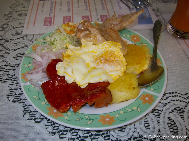 Llapingachos, served with chicken, egg, and salad is typical of Ecuadorian food