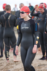 duathlon(0.0), endurance sports(1.0), triathlon(1.0), sports(1.0), wetsuit(1.0), spandex(1.0),