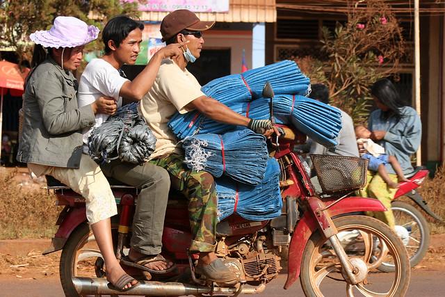 Fully loaded motorbike in Sen Mororom Cambodia.