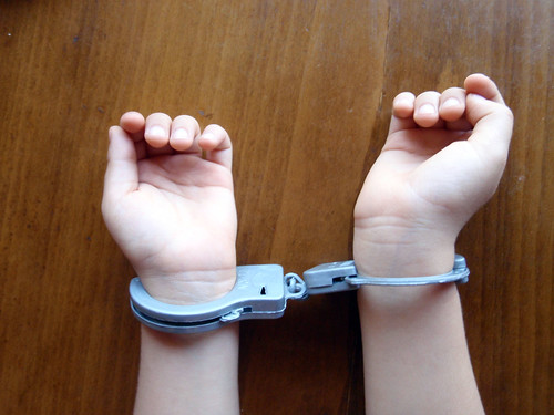 Stock photo of child under arrest
