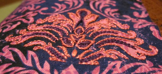 Embroidery-embossed fabric