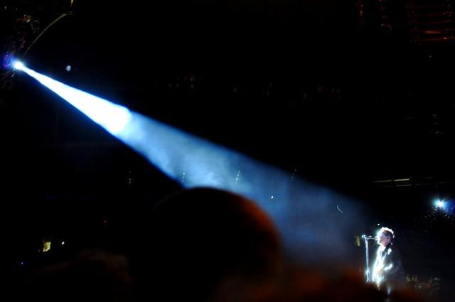 Stage light on Bono