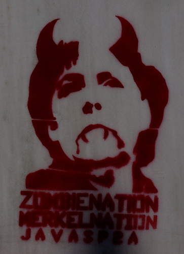 Zombie nation, Merkel nation . Stencil on the wall of a building in Thessaloniki, Greece
