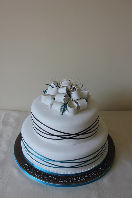 chocolate and teal wrapped ribbon wedding cake