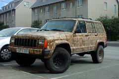 jeep liberty(0.0), automobile(1.0), automotive exterior(1.0), sport utility vehicle(1.0), jeep cherokee (xj)(1.0), wheel(1.0), vehicle(1.0), compact sport utility vehicle(1.0), off-roading(1.0), jeep(1.0), off-road vehicle(1.0), bumper(1.0), land vehicle(1.0), motor vehicle(1.0),
