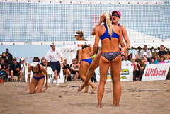 beach handball(0.0), volleyball player(1.0), ball over a net games(1.0), volleyball(1.0), sports(1.0), competition event(1.0), team sport(1.0), ball game(1.0), beach volleyball(1.0), bikini(1.0), athlete(1.0),