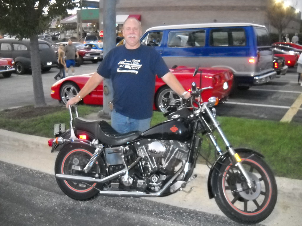 jay judd with his vintage harley davidson at the perring parkway cruise in.