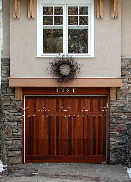 Wood carriage style garage doors offered by vault for R value of old wood garage door