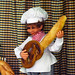 Mechanical doll with bread guitar