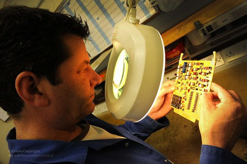 Civilian Technician Inspects Circuit Board at Army Aviation Centre Middle Wallop
