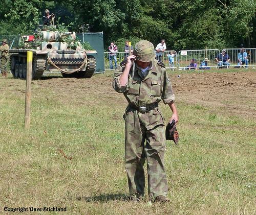 Panzer Grenadier and mobile adjusts helmet