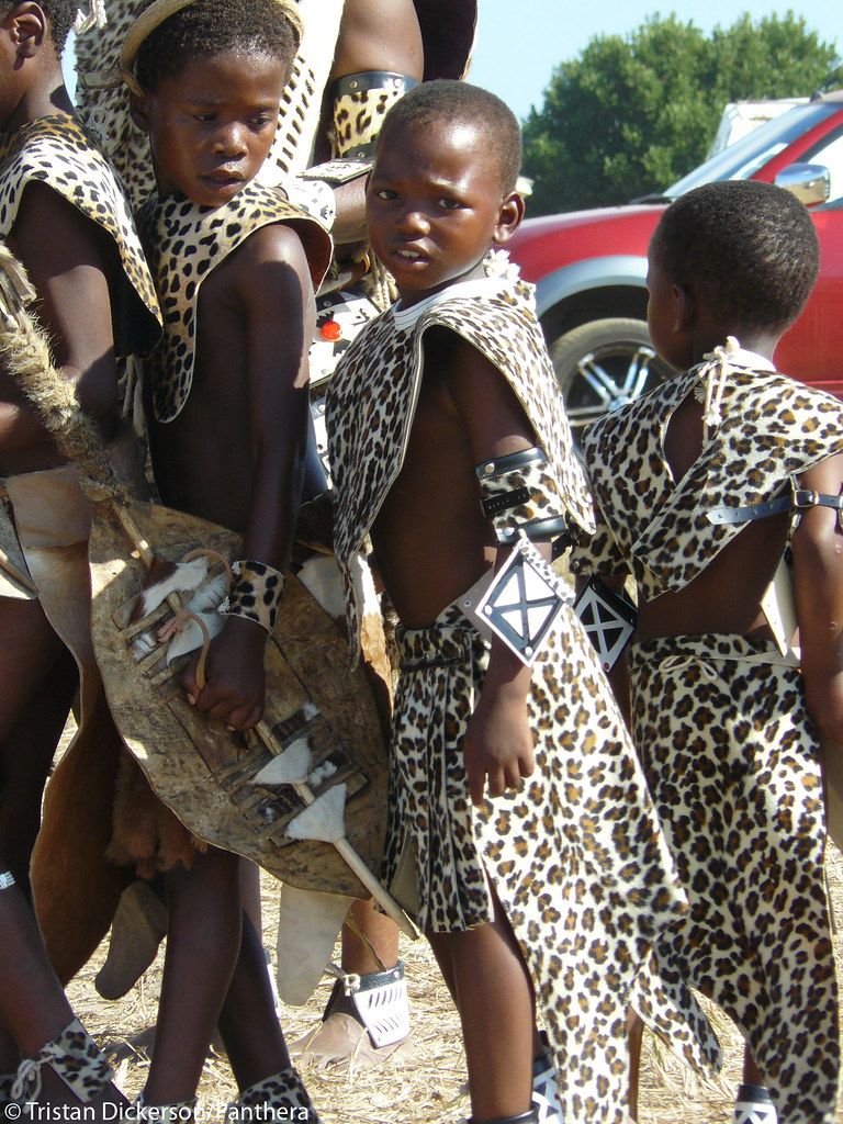 Children wearing printed skins