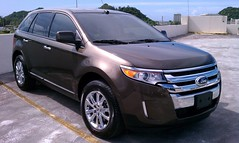 executive car(0.0), ford escape(0.0), automobile(1.0), automotive exterior(1.0), sport utility vehicle(1.0), ford edge(1.0), vehicle(1.0), compact sport utility vehicle(1.0), crossover suv(1.0), bumper(1.0), ford(1.0), land vehicle(1.0), luxury vehicle(1.0),