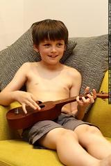 nick plays ukulele