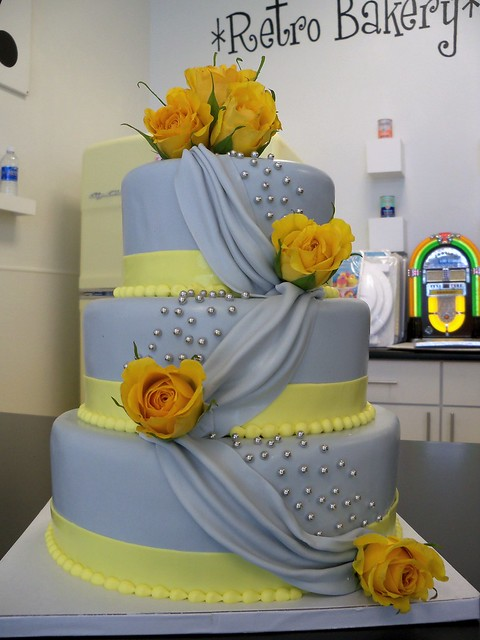 Grey and Yellow draped fondant wedding cake