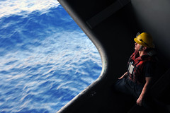 In this file photo, Boatswain's Mate 3rd Class Samuel Mott watches a fuel line during a fueling at sea in the Pacific Ocean aboard the aircraft carrier USS George Washington (CVN 73) Aug. 20, 2011. (U.S. Navy photo by Mass Communication Specialist Seaman Alysia R. Hernandez)