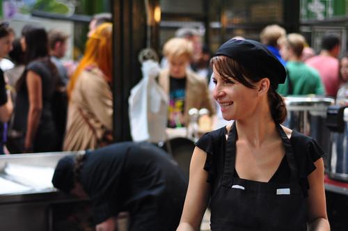 Barista smiling at counter