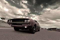 monochrome(0.0), automobile(1.0), wheel(1.0), vehicle(1.0), automotive design(1.0), dodge challenger(1.0), land vehicle(1.0), muscle car(1.0), supercar(1.0), sports car(1.0),