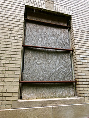 Abandoned Church of Christ Science: Boarded windows