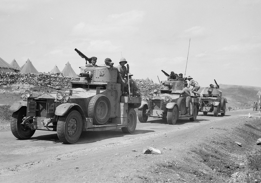Detailed photo showing British Army armoured cars of the 11th Hussars on the Nablus road, in front of Camp K, Palestine . circa 1938