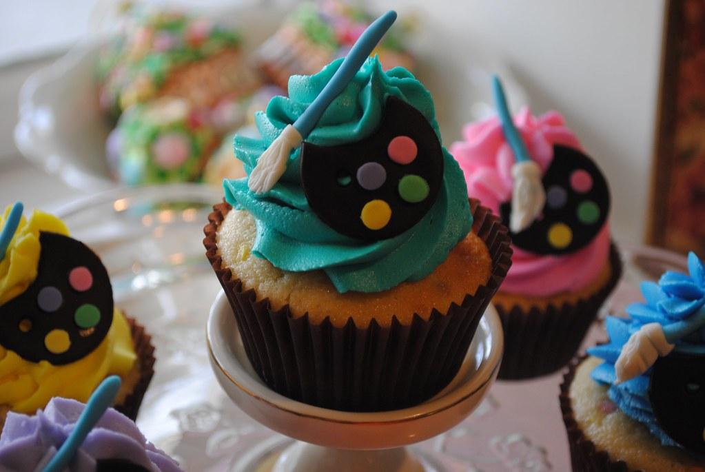 Artist easel and blackberry vanilla bean cupcakes