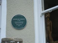 Photo of Gertrude Hermes green plaque