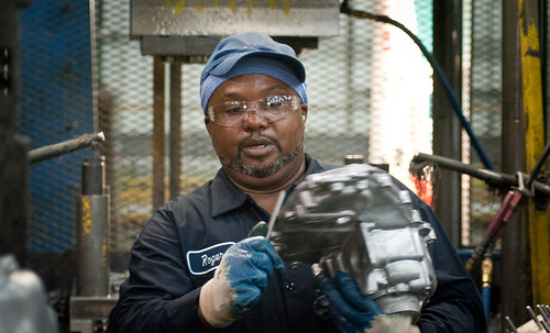 Trim Operator Roger Brown at Port City Group's Port City Castings Corporation manufacturing high-pressure aluminum die-castings