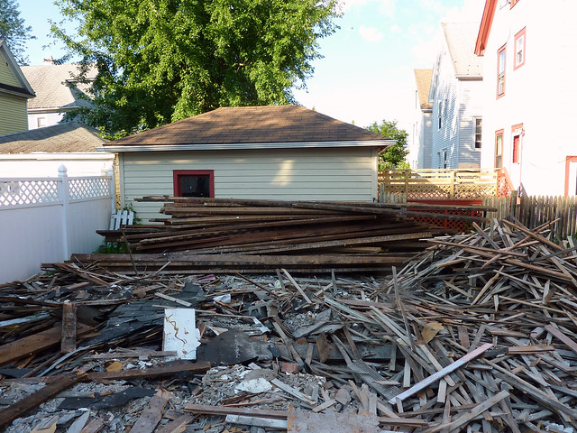 Debris in the front; reusable lumber in the back