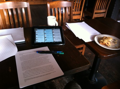 Paper, pen, HP TouchPad, coffee, scone. All important tools of the trade #academia