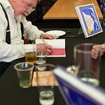 Alasdair Gray signing books |