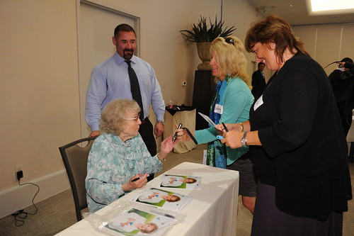 Betty White signs autographs at the Lifeline Program Luncheon