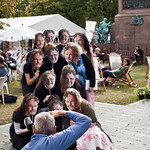 Press shot | Book Festival staff have fun posing as Alasdair Gray look alikes for a press photographer