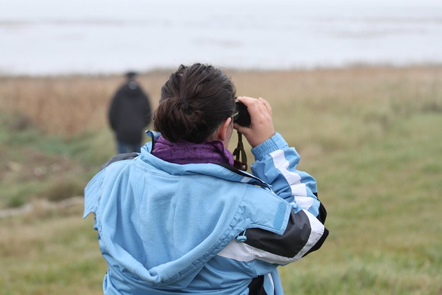 Ann with binoculars looking at birds