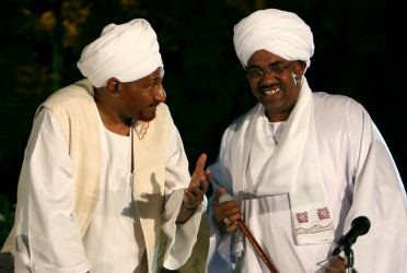 Sudan President Omar Hassan al-Bashir in dialogue with former prime minister and Umma Party leader al-Sadiq al-Mahadi. The Umma Party has broken off discussions. by Pan-African News Wire File Photos