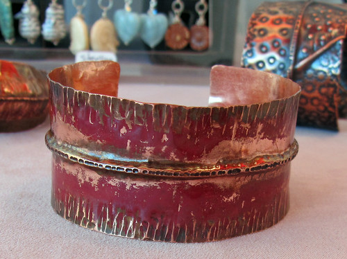fold formed cuff with red fire scale