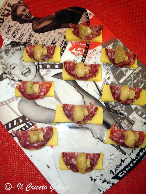 Antipasto di polenta al tartufo e salame di bufalo