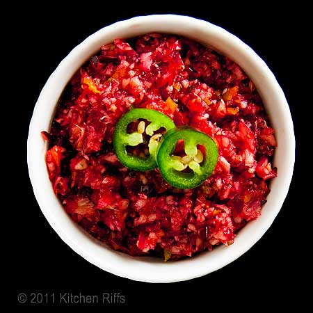 Cranberry Jalapeno Relish in white ramekin on black background
