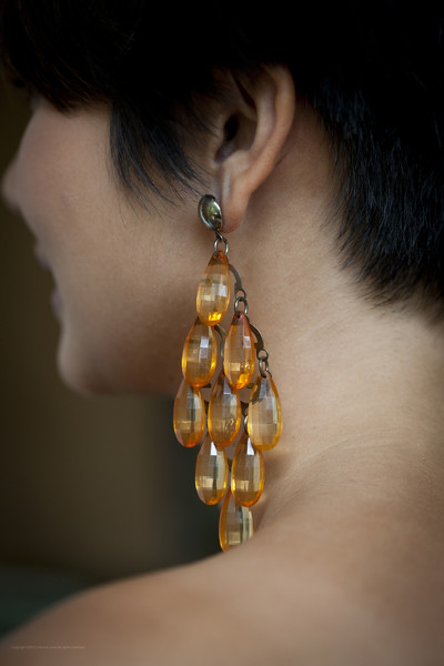 Back view of the beautiful orange beads that capture light with every move!