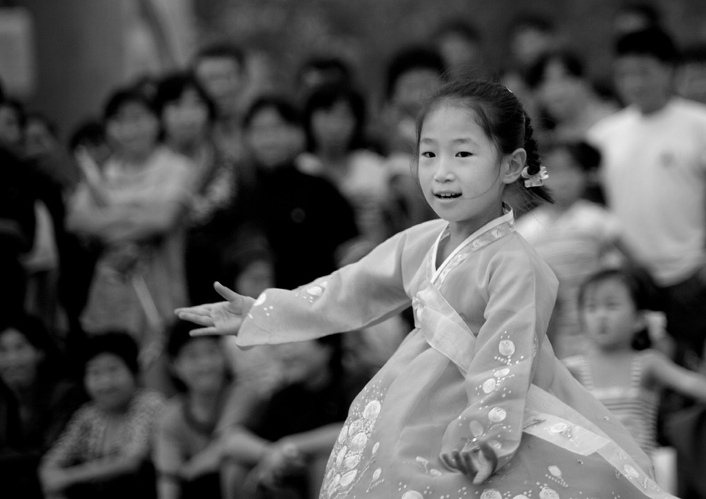 Kid dancing in the street - Pyongyang North Korea
